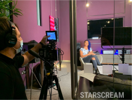 Lucy Hedges being filmed at Starscream HQ
